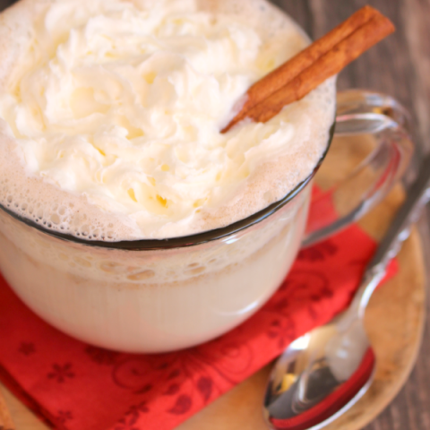 The ultimate hot buttered rum recipe for a cold night! This creamy, hot cocktail is made with spiced rum, cinnamon and ice cream to make it wonderfully decadent and delicious. This Hot Buttered Rum goes perfectly with fuzzy slippers, fireplaces and your favorite Christmas movie!