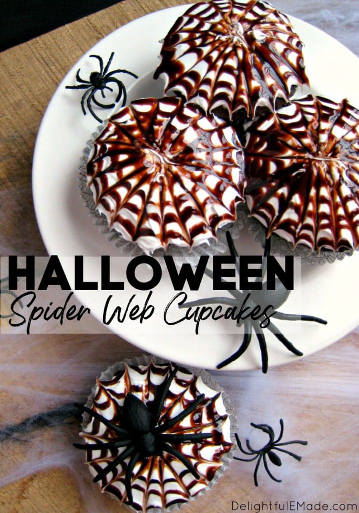 Halloween spider web cupcakes, decorated with chocolate syrup swirl and black plastic spiders on the side.