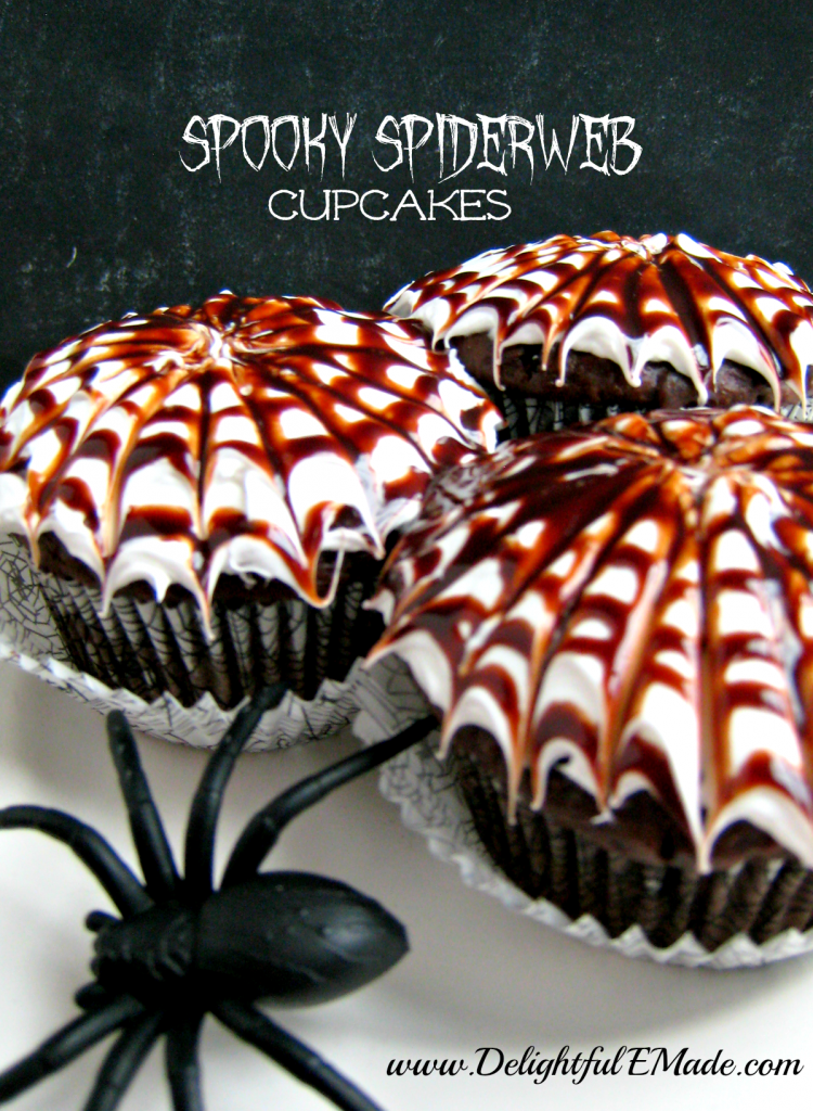 "Moist chocolate cupcakes are topped with a vanilla frosting and chocolate swirl spiderwebs, making these cupcakes ""Spooktacular!"
