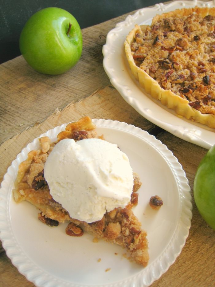 Easy as pie, this Dutch Apple Tart is an even easier version of the classic pie recipe! Sweet, tender apples, and a brown sugar cinnamon pecan crumble are baked to perfection making this tart a perfect addition to your holiday dessert table! Fantastic for Thanksgiving and Christmas dinner!