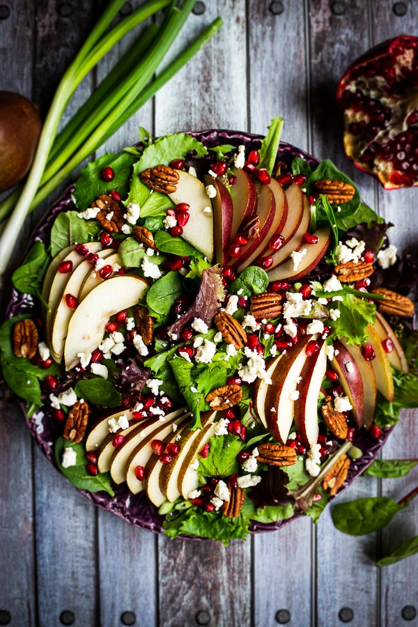 Looking for an amazing pear salad recipe? My Harvest Salad with Pears and Pomegranates is fantastic! Beautiful enough for a Thanksgiving or Christmas side dish and simple enough to make for weekday lunch paired with chicken or turkey!