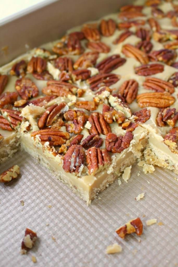 Cross between pecan pie and pecan sandies, these buttery, delicious Pecan Praline Bars are perfect any time you're in the mood for something sweet! An amazing pecan shortbread crust, a delicious caramel filling and topped with brown sugar toasted pecans, these bars are incredible! The perfect addition to your holiday cookie trays!