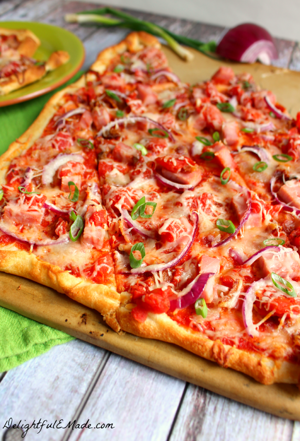 Smokey bacon, ham, red and green onions and plenty of cheese top this delicious thin crust pizza! The perfect dinner option for any night of the week!