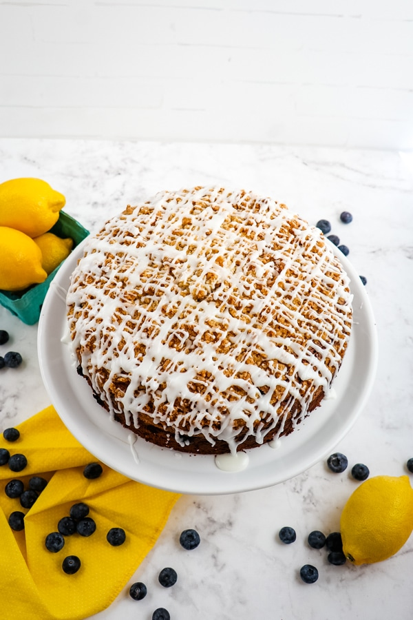 Lemon blueberry coffee cake, frosted on platter.