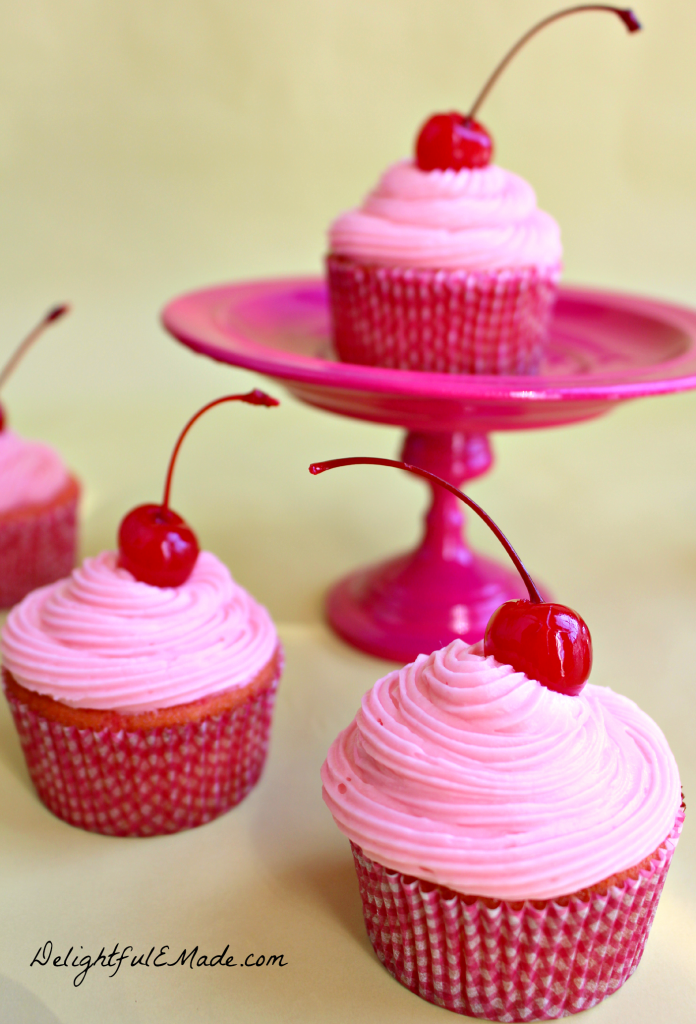 The ultimate pink cupcake!  Moist, rich cherry cake bejeweled with cherries, topped with a creamy cherry frosting and a cherry on top!