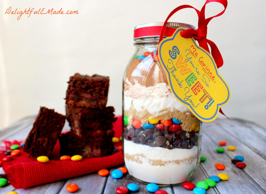 "Everyone loves brownies!! Why not give it as a gift? This easy M&M Brownie mix in a jar is the perfect ""Thank You"" gift for anyone in your life. Makes a great teacher appreciation gift!"