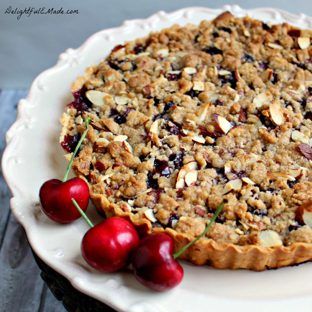 This delicious tart is filled with the flavors of summer! Made with fresh cherries, its easy to make, and is incredible with a big scoop of ice cream!