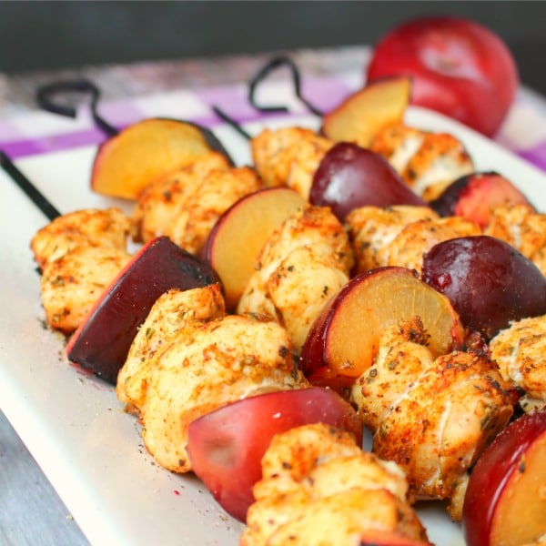 Meet your new favorite way to make Grilled Chicken Skewers! Simple chicken breasts are paired with sweet, summer plums making this grilled chicken recipe a summer dinner favorite! A fantastic plum recipe, too!