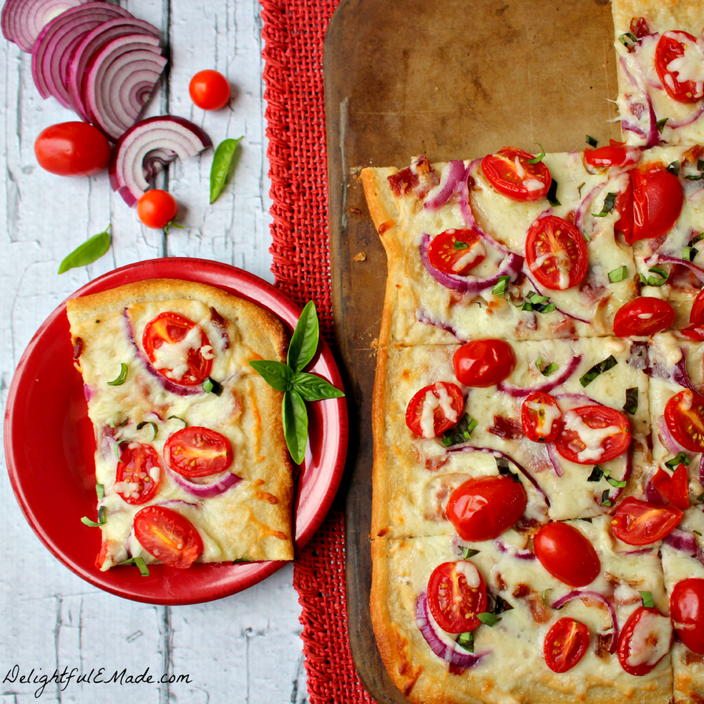 A pizza-lovers dream!  Loaded with cheesy Alfredo sauce and topped with fresh, delicious tomatoes, onions, basil and savory bacon, this pizza is perfect for pizza night or for an easy dinner solution any night of the week!