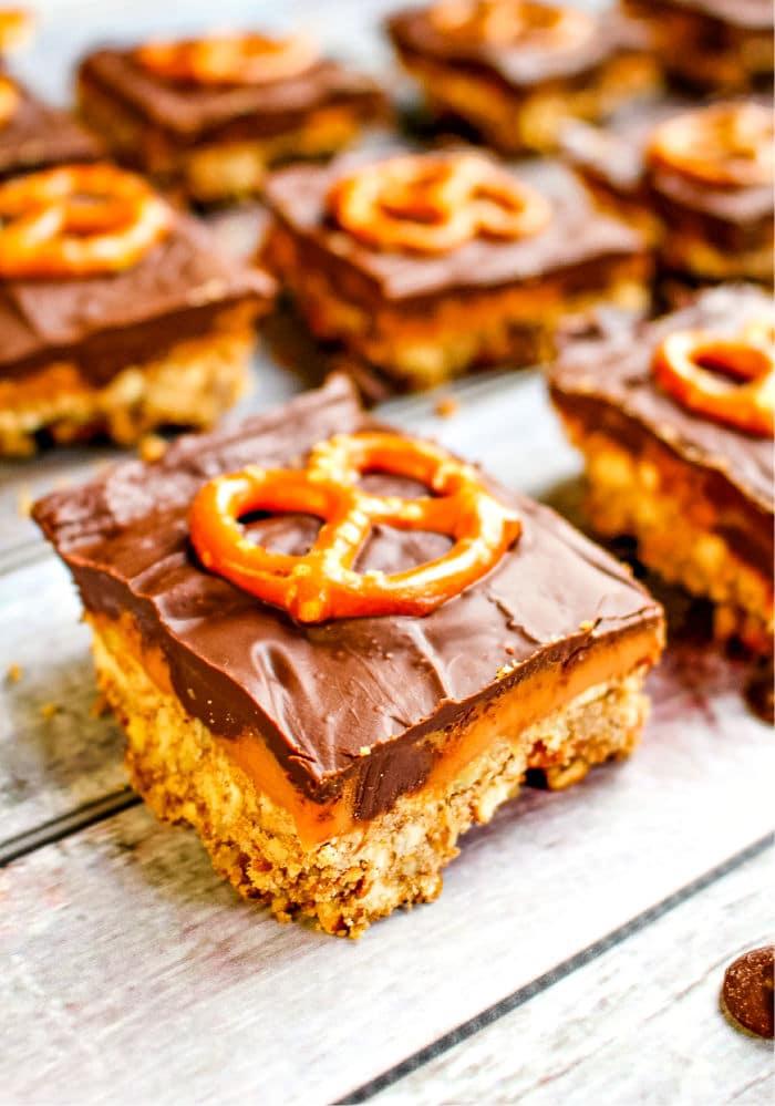 Squares of chocolate caramel pretzel bars.