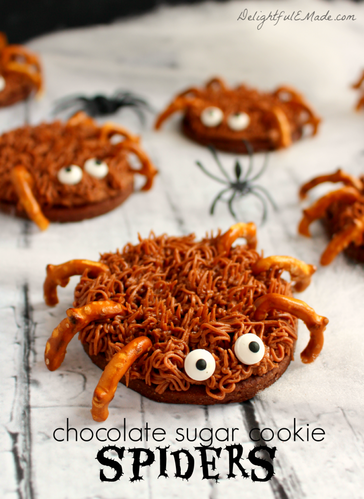 The perfect treat for your next Fall or Halloween Party! Made with chocolate sugar cookies, pretzel legs and candy eyes, they're scary delicious!