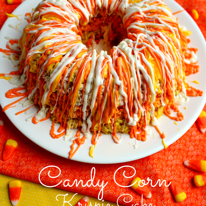 If you like candy corn and rice krispie treats, you'll love this!! Layered to look like candy corn, and drizzled with candy melts, its the perfect fall treat!