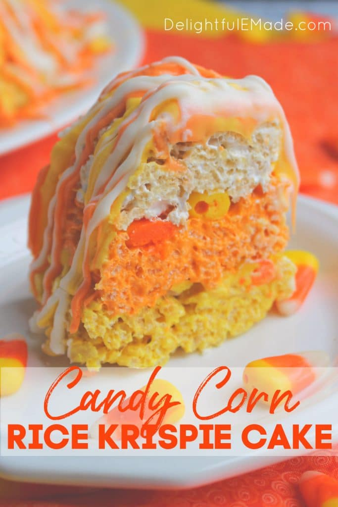 Slice of candy corn krispie cake on white plate, garnished with pieces of candy corn.