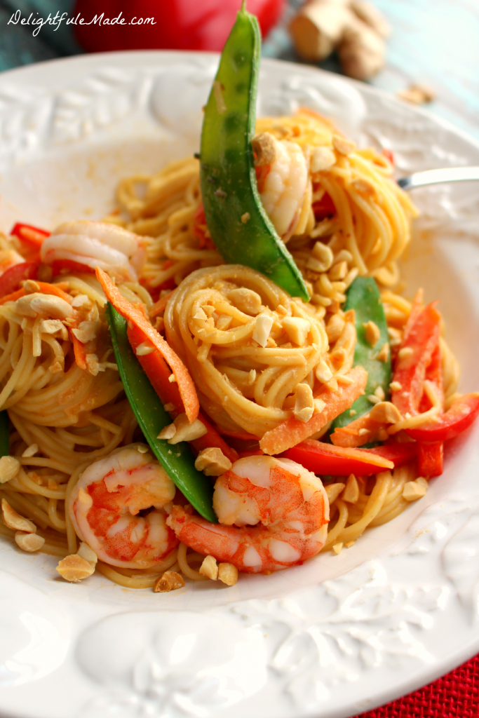 This Thai Peanut Pasta with Shrimp is a healthy, easy, delicious dinner solution for any night of the week! Angel Hair pasta is tossed with fresh veggies, tender shrimp, a delicious Thai peanut sauce, and topped with crunchy peanuts to make a delicious meal. This pasta dish will be a new favorite with your family!