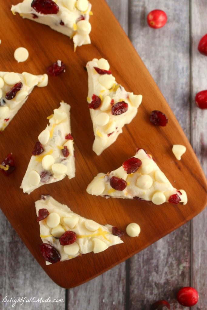 If you like the Starbucks Cranberry Bliss Bars, then you'll LOVE this Cranberry Bliss Fudge!  Made with white chocolate, lemon zest, and bejeweled with cranberries, it will be your new favorite holiday treat.  The perfect Christmas fudge recipe!