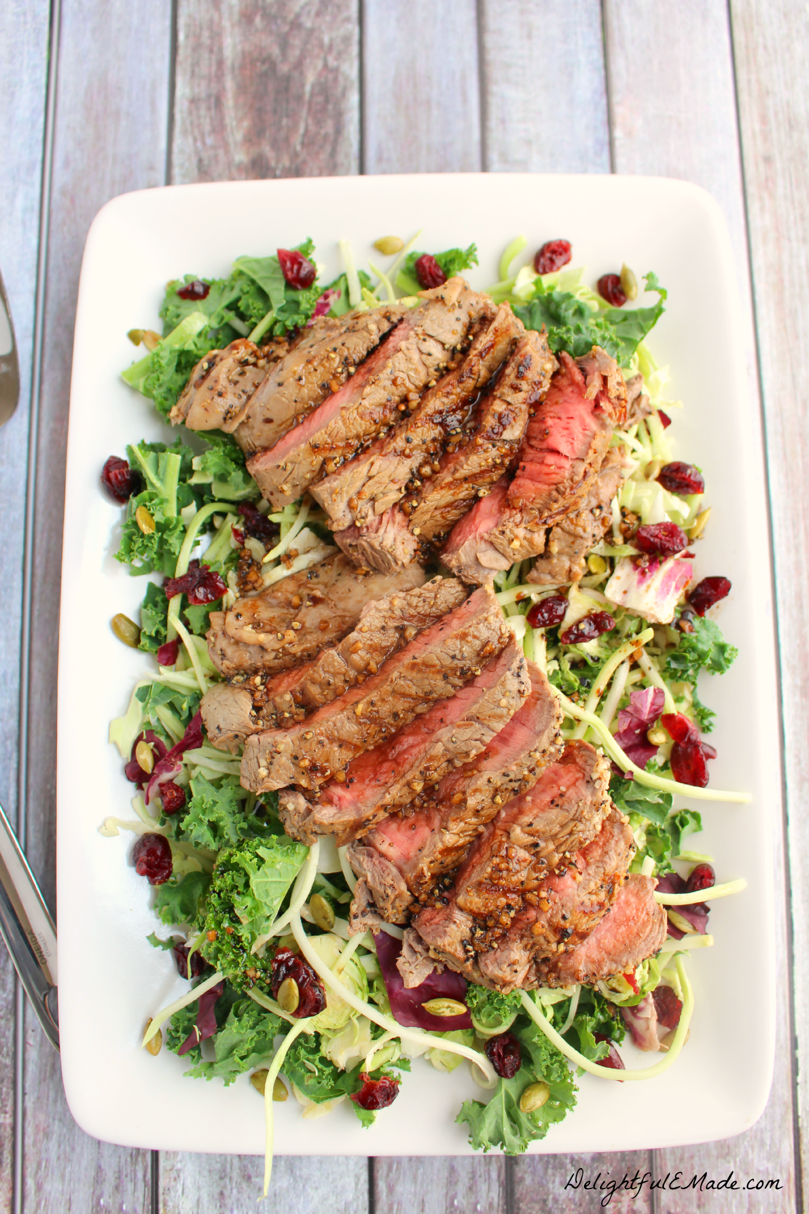 The perfect entree salad for the meat lover! Loaded with crunchy, delicious kale, Brussels sprouts, shredded broccoli, cabbage and chicory and topped with grilled sirloin steak, this salad is incredible. Fresh, filling and perfect for lunch or a light dinner!