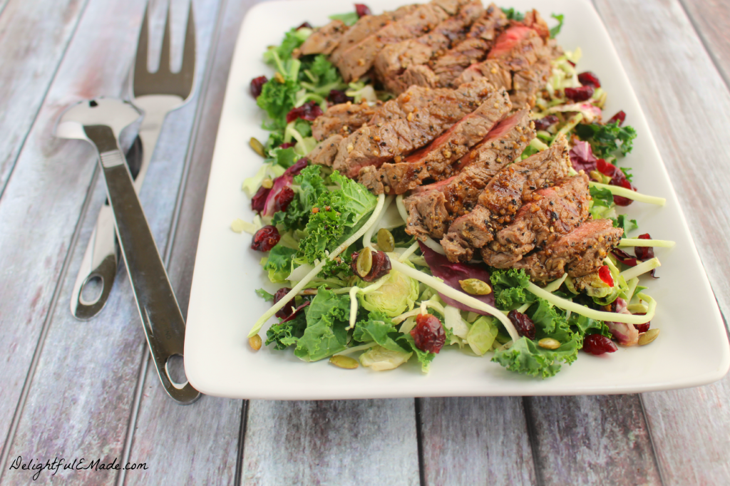 Loaded with crunchy, delicious kale, Brussels sprouts, shredded broccoli, cabbage and chicory and topped with grilled sirloin steak, this salad has a mildly sweet, peppery flavor. Fresh, filling and perfect for lunch or a light dinner!