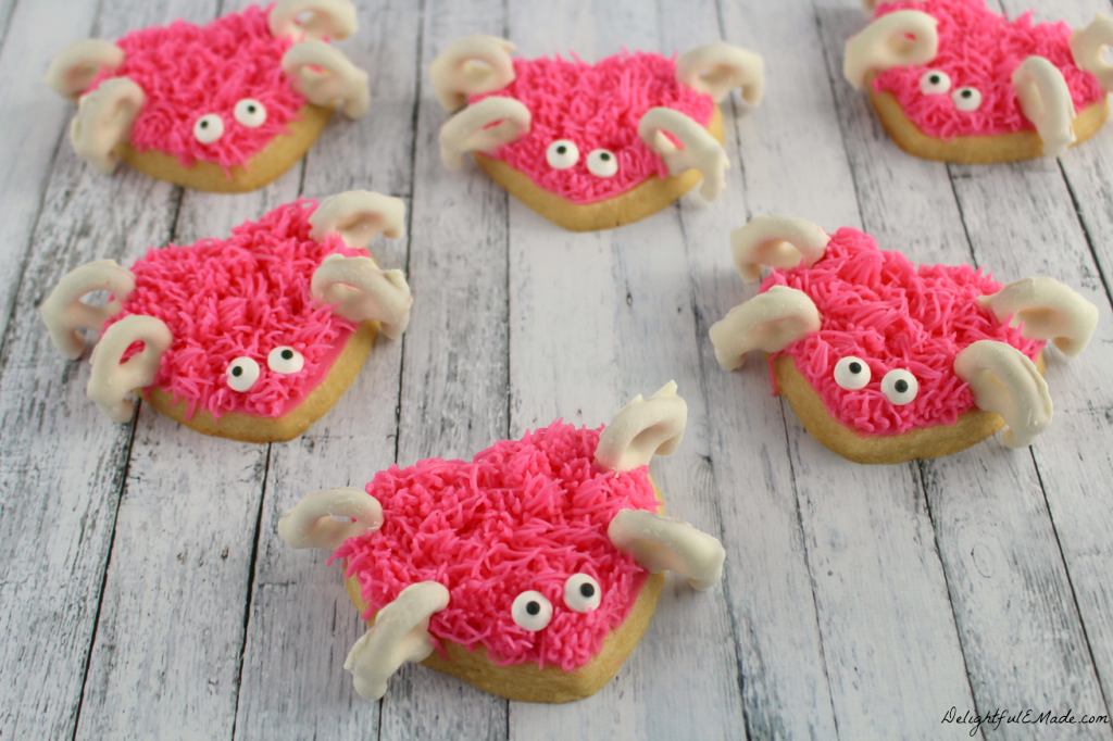 These adorable heart shaped sugar cookies are frosted with pink icing and decorated with yogurt covered pretzels to create these super-sweet Love Bugs! The perfect Valentine's Day treat!