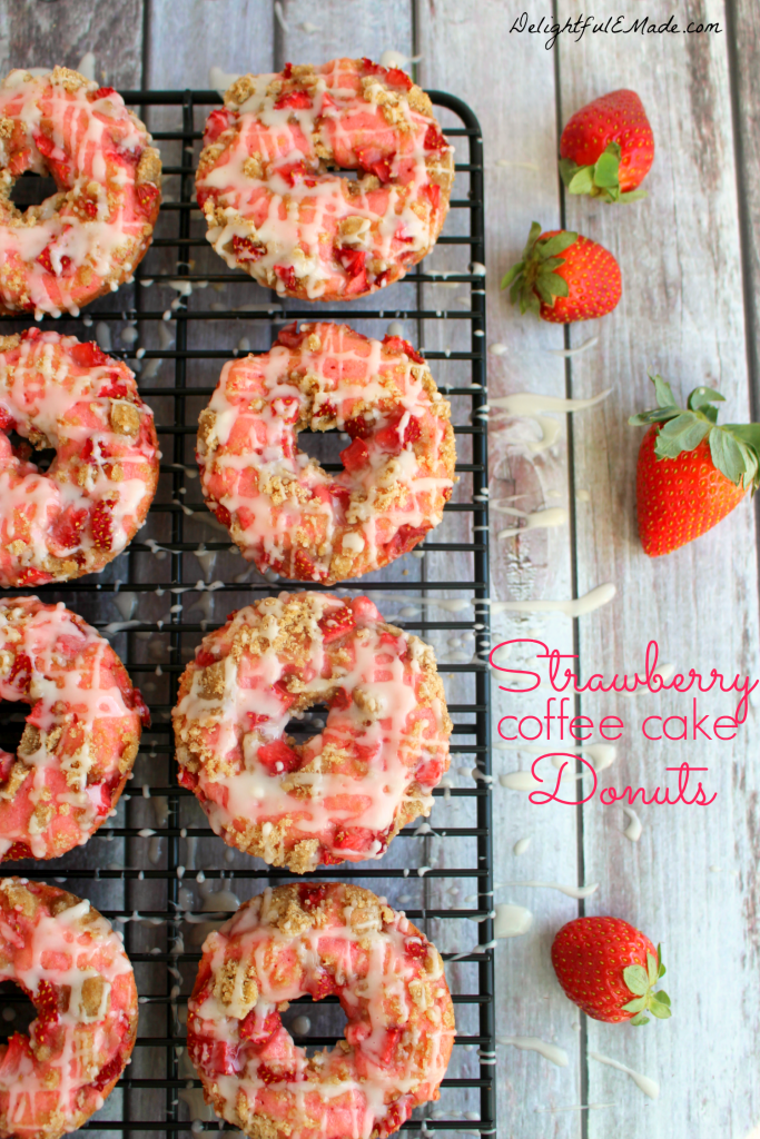 These Strawberry Coffee Cake Donuts are loaded with fresh, chopped strawberries, topped with coffee cake streusel and drizzled with glaze.  Breakfast treats have never been more pretty or tasty as these!