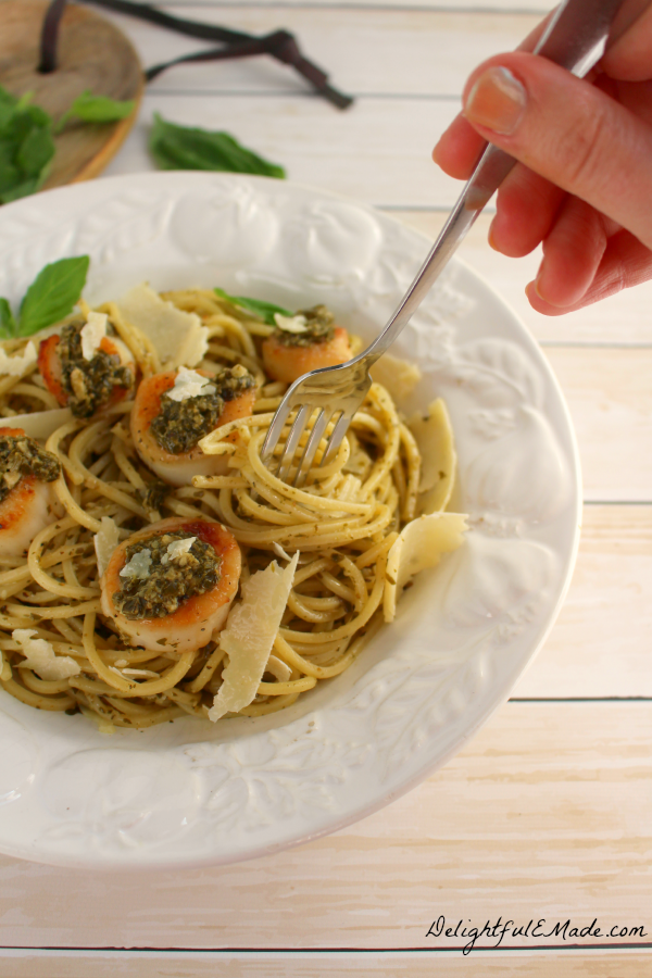 Spaghetti alla Chitarra pasta is paired with pesto sauce, pan seared sea scallops and fresh Parmesan Reggiano cheese for a wonderfully delicious meal!
