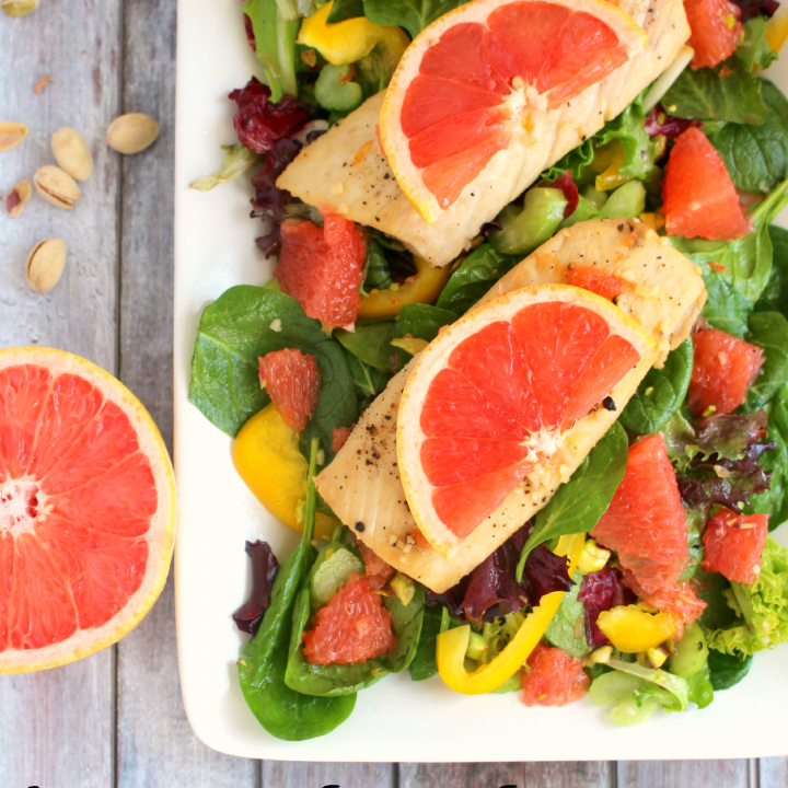 Tossed with delicious Florida Red Grapefruit along with spinach, yellow bell peppers and pistachios, and topped with a grapefruit glazed, pan seared Mahi Mahi, this salad is fresh, healthy and fabulous!
