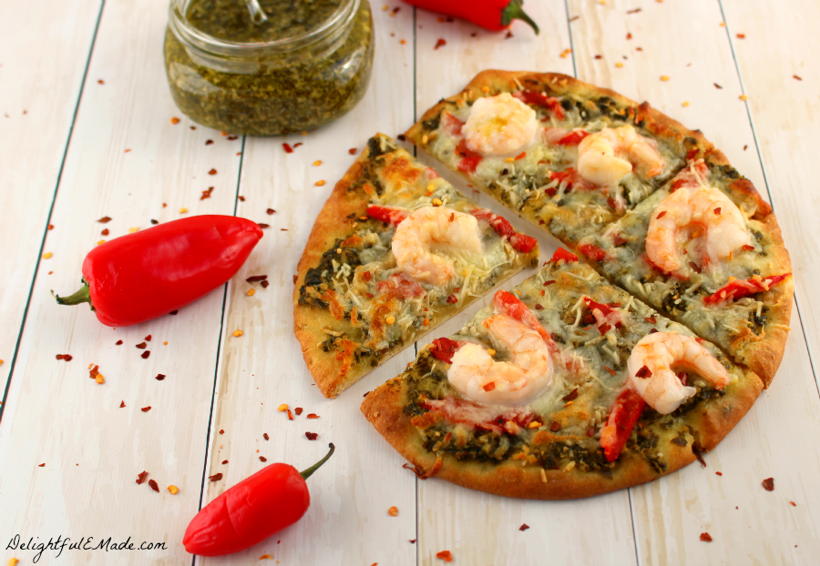 Pesto sauce, roasted red peppers, and shrimp top this quick and easy pizza that's perfect for any night of the week!