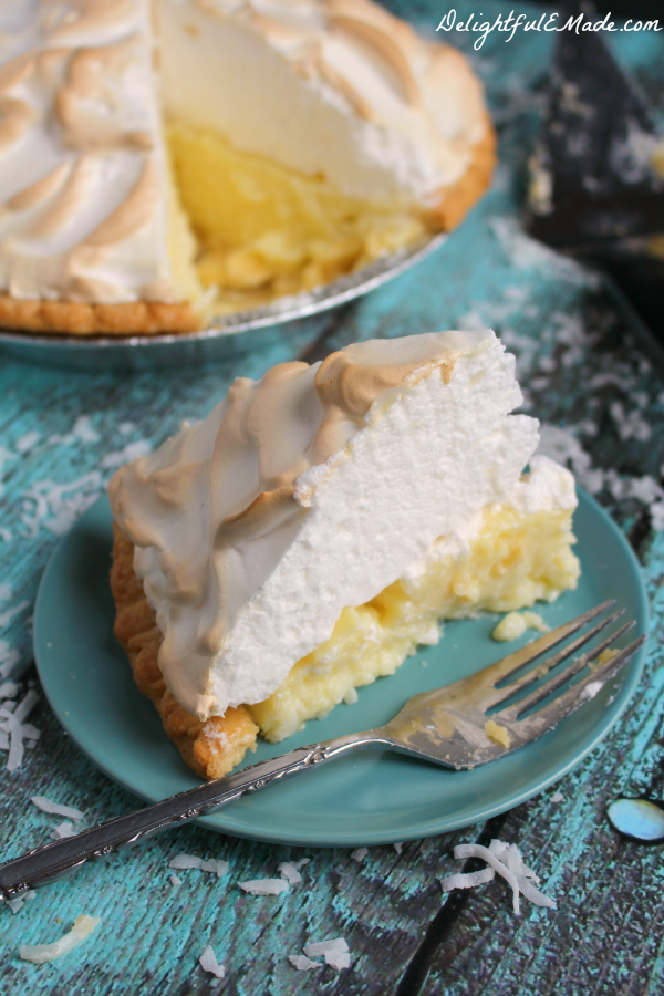 The cream pie recipe of your dreams! This classic Coconut Cream Pie is made with a gorgeous meringue and perfectly creamy coconut custard filling.  My mom is famous for this pie for good reason - it's completely incredible!