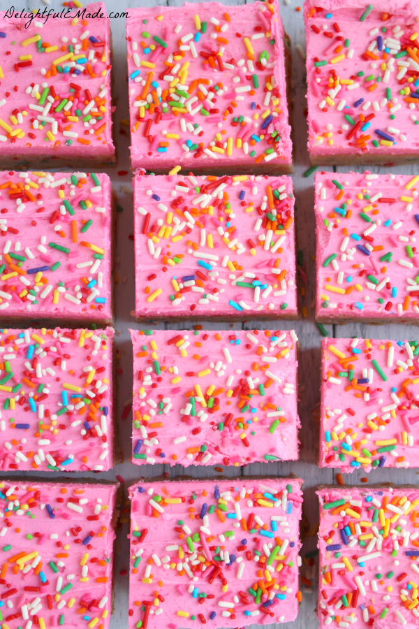 Every sprinkle-lovers dream! These thick, chewy frosted sugar cookie bars are loaded with sprinkles and topped with a thick layer of rich butter cream frosting. So good, you won't be able to eat just one!