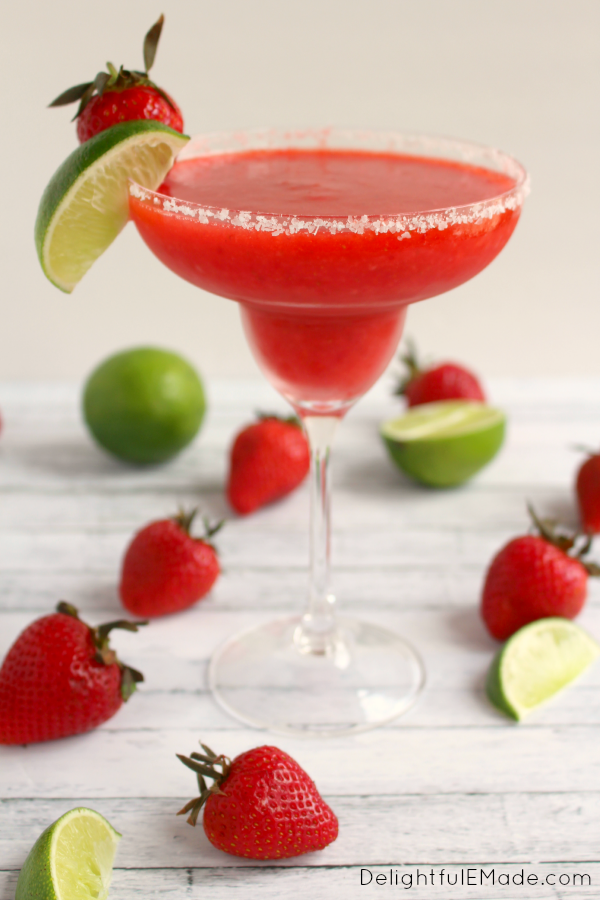 Bust out the tequila, its time for a Margarita!  Blended with frozen strawberries, lime juice, and rimmed with salt, these frozen margaritas are easy to make, wonderfully refreshing and an all-time favorite cocktail!