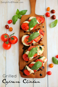 One seriously amazing grilled chicken recipe! Fresh tomatoes, basil and mozzarella top these balsamic vinaigrette marinated chicken breast, and grilled to perfection. Done and on the table in 20 minutes! Perfecto!!