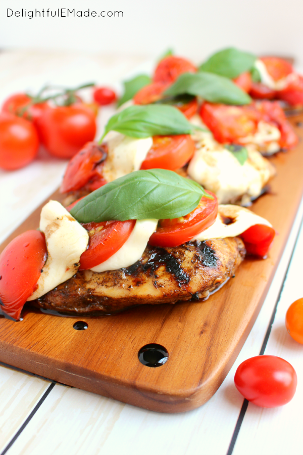 One seriously amazing grilled chicken recipe!  This Caprese Chicken includes fresh tomatoes, basil and mozzarella topped on balsamic vinaigrette marinated chicken breasts, and grilled to perfection.  Done and on the table in 25 minutes!  Perfecto!!
