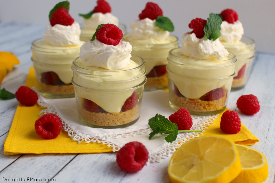 Cool, fresh and loaded with lemon and raspberry flavor, these no-bake cheesecake cups are amazing!  Made with a lemon oreo crust, fresh raspberries and a creamy lemon cheesecake filling, these yummy cups are an easy and delicious summer dessert!