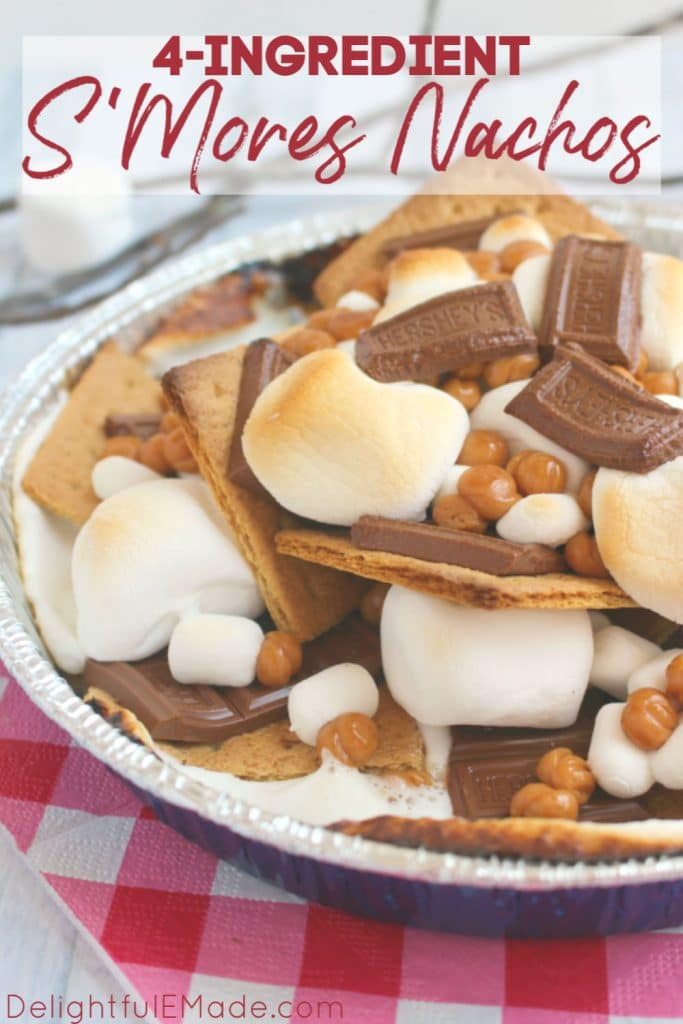 S'mores nachos made in a pan with graham crackers, Hershey bars, marshmallows and caramel bits.