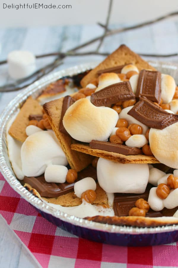 S'mores nachos in pan with toasted marshmallows, melted Hershey bars, caramel bits and graham crackers.