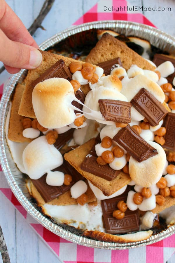S'mores nachos overhead shot of toasted marshmallows and melted hershey bar and caramel bits
