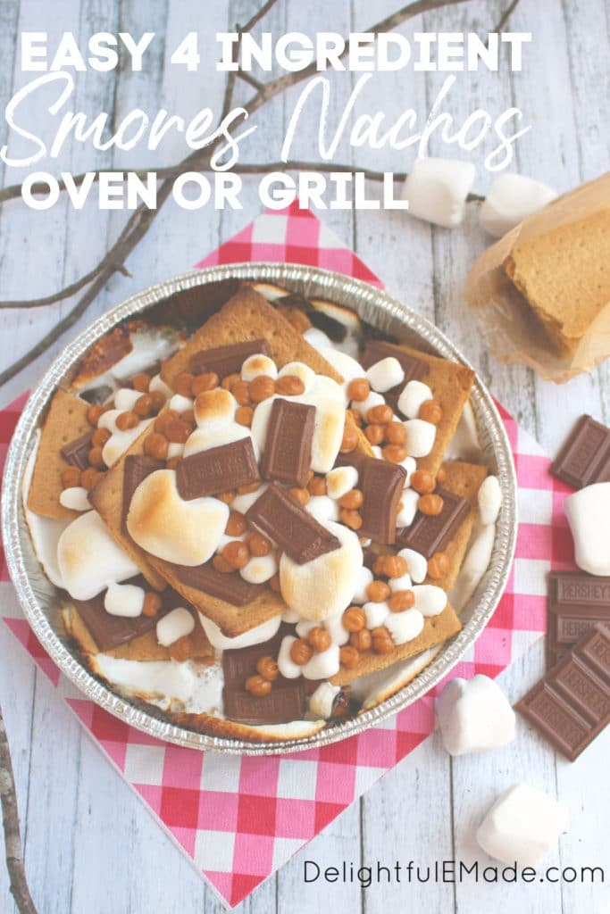S'mores nachos in a pan with graham crackers, Hershey bars, marshmallows and caramel bits.