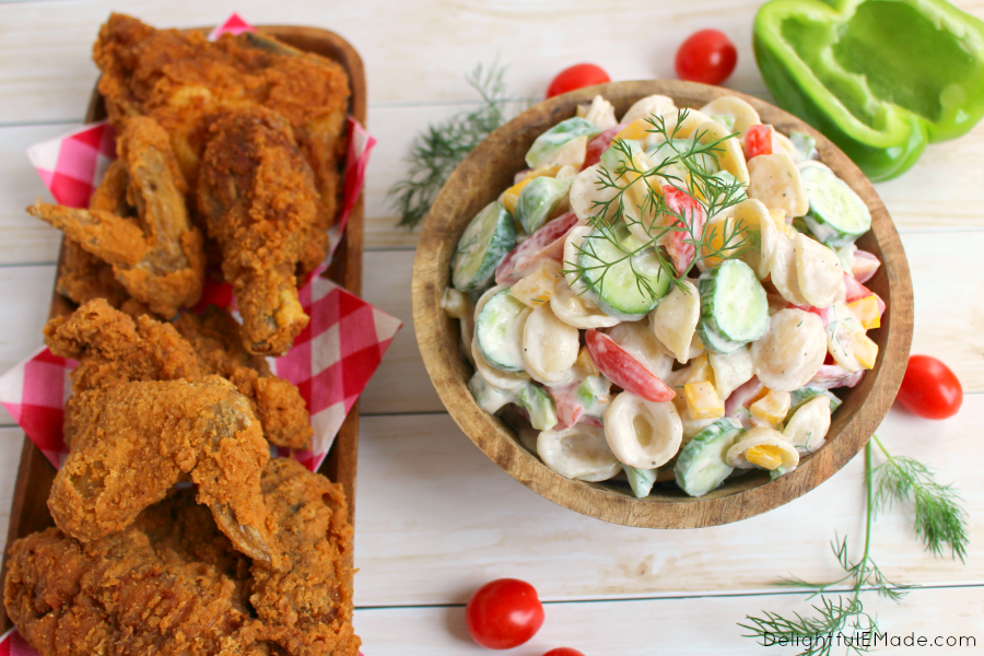 You'll never believe this pasta salad is light and healthy! Made with a delicious Greek yogurt dressing and loaded with fresh garden vegetables, this pasta salad will be your new favorite summer side dish!