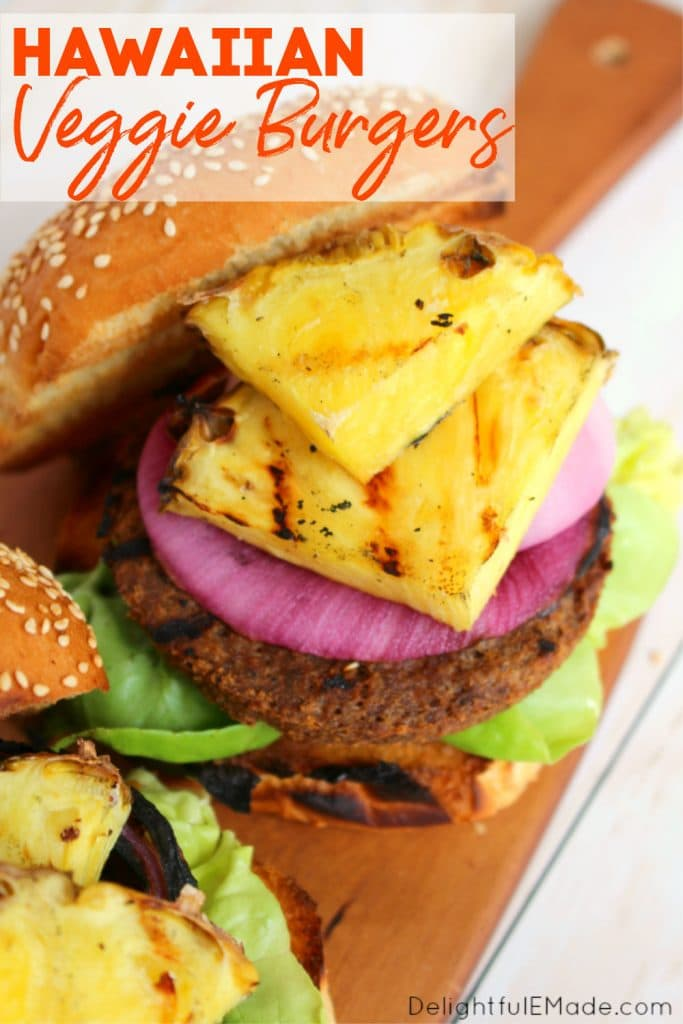 Hawaiian veggie burgers on a grilled sesame bun topped with grilled pineapple, red onion and lettuce.