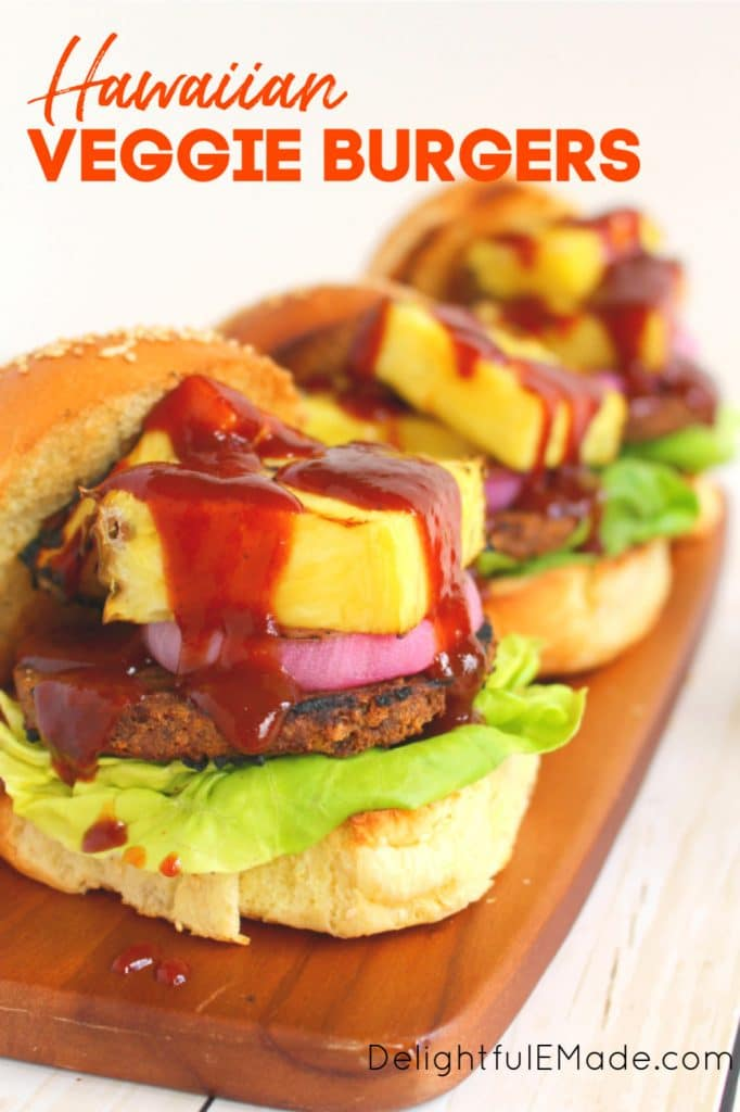 Grilled Hawaiian veggie bugers on top of grilled buns, with lettuce, red onion and grilled pineapple wedges.