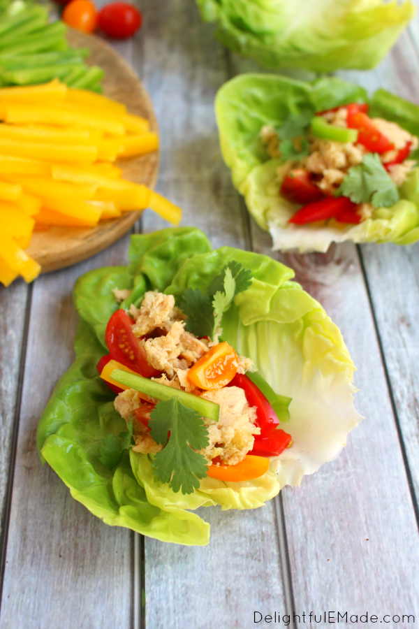 Lettuce wraps brought to a whole new delicious level!  Jalapeno infused tuna is paired with crunchy peppers, fresh cilantro and juicy tomatoes for a healthy, easy & delicious lunch! Gluten free and Paleo friendly, too!