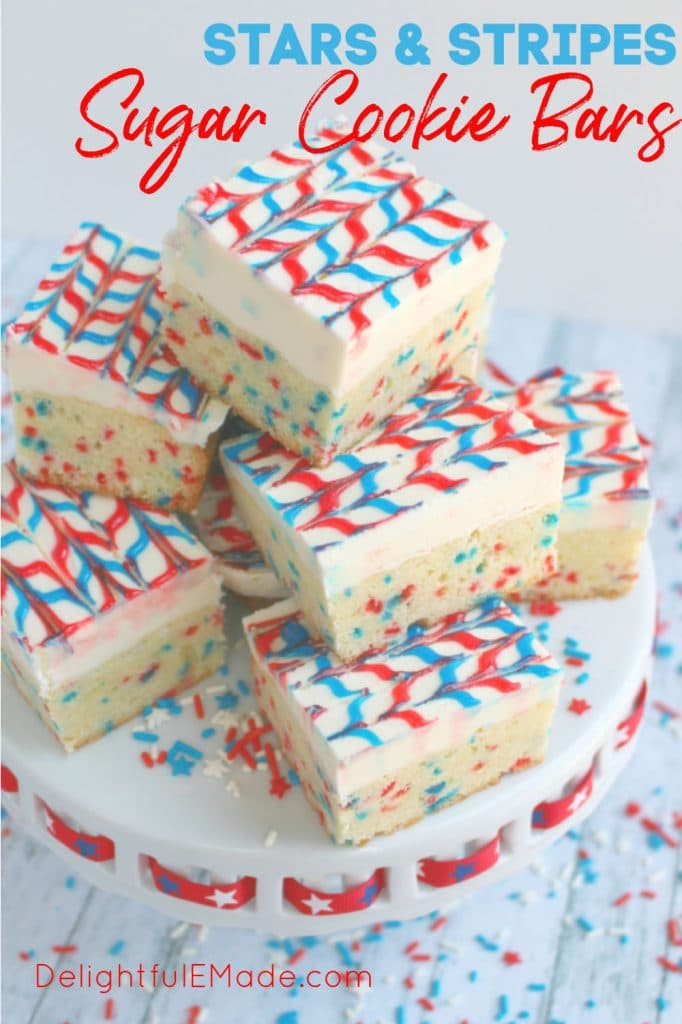 Red, white and blue sugar cookie bars, decorated with red and blue gel frosting, placed on a white platter
