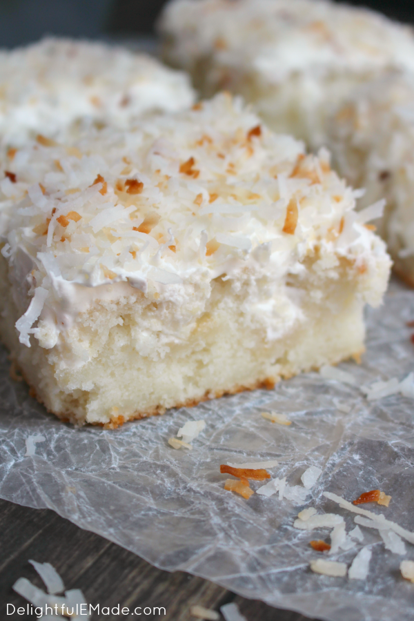 A dreamy, delicious coconut cake that will have you coming back for seconds!  This Coconut Cream Poke Cake uses a simple white cake mix, then topped with cream of coconut, coconut whipped topping and sprinkled with toasted coconut for the ultimate coconut cake recipe!