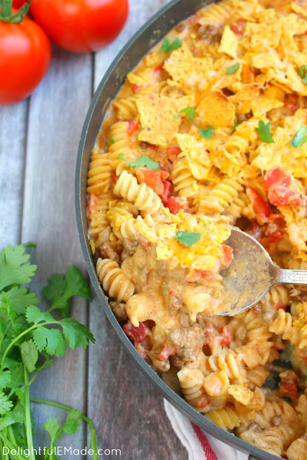 Need an easy, delicious dinner idea that everyone will love? Try my Taco Mac and Cheese! Loaded with two types of cheese, pasta, tomatoes, and topped with tortilla chips and more cheese, this will be a new family favorite!