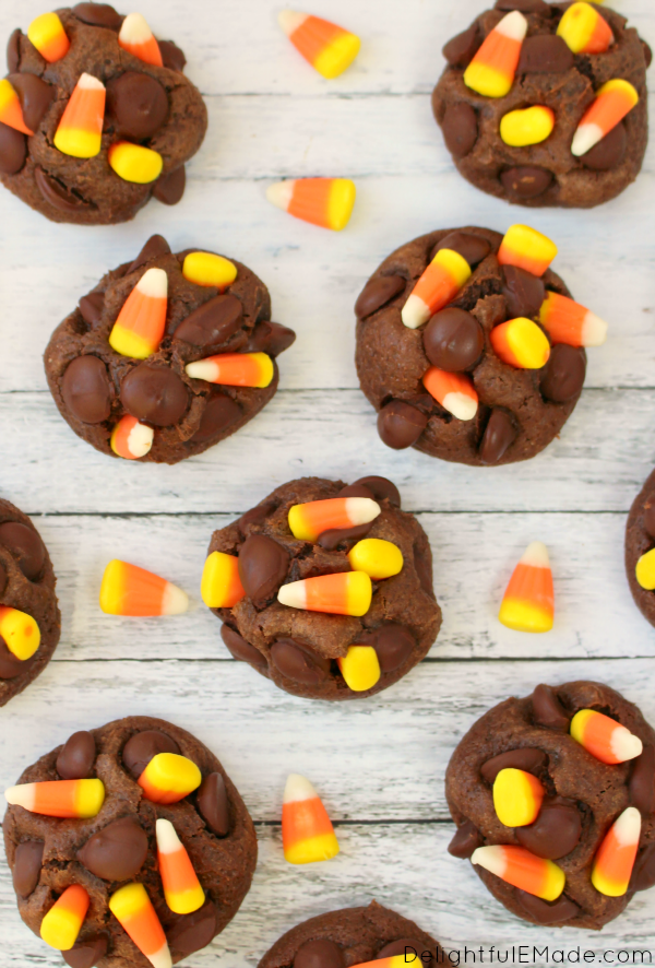 Soft, fudgy chocolate cookie dough paired with the fall classic candy corn come together for an incredibly moist, chewy cookie!  Studded with big semi-sweet chocolate chips and topped with candy corn, these cookies will be a new favorite with everyone in your family!  The perfect fall treat!