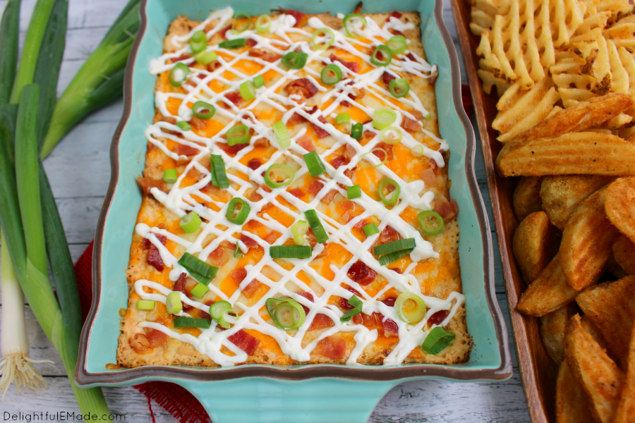 All of the amazing toppings on a loaded baked potatoes in one hot, glorious dip! Served with potato wedges and waffle fries, this hot, cheesy appetizer is one that everyone will love when watching the big game!