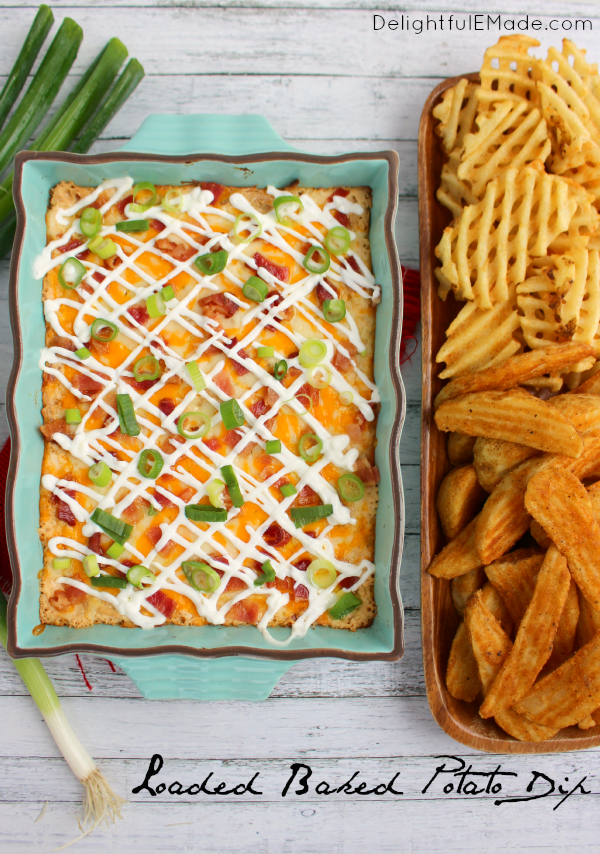 All of the amazing toppings on a loaded baked potatoes in one hot, glorious dip!  Served with potato wedges and waffle fries, this hot, cheesy appetizer is one that everyone will love when watching the big game! Fantastic for parties, holidays and get-togethers, too!