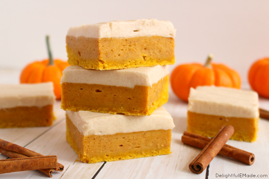 Sugar Cookie Bars with a delicious fall twist! Cinnamon cream cheese frosting tops these wonderfully chewy, delicious pumpkin cookie bars. Pairs perfectly with the fall favorite pumpkin spice latte!