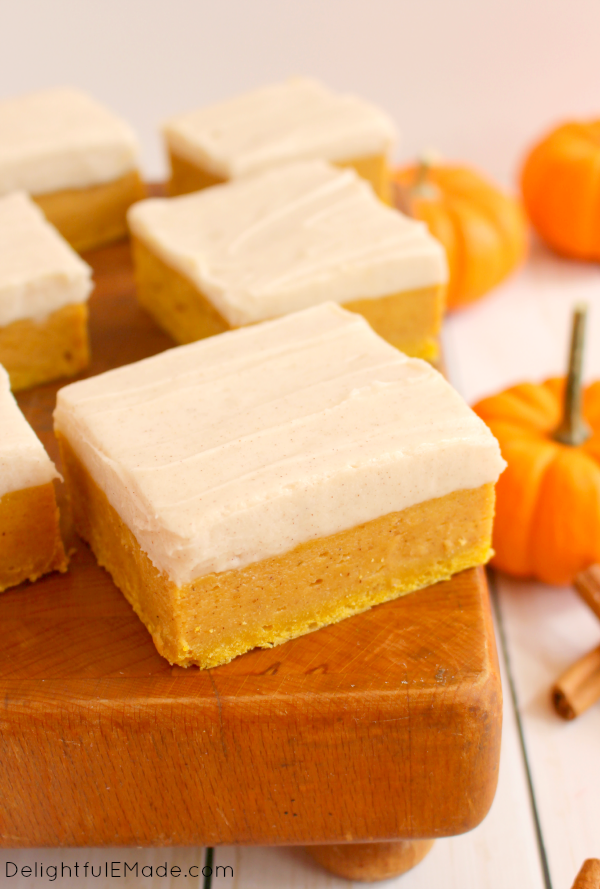 Sugar Cookie Bars with a delicious fall twist!  Cinnamon cream cheese frosting tops these wonderfully chewy, delicious pumpkin spice treats!  Pairs perfectly with the fall favorite pumpkin spice latte!