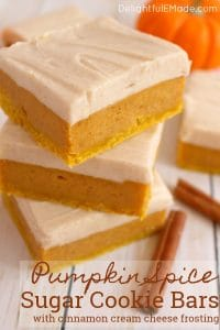 Sugar Cookie Bars with a delicious fall twist!  Cinnamon cream cheese frosting tops these wonderfully chewy, delicious pumpkin bar recipe.  Pairs perfectly with the fall favorite pumpkin spice latte!