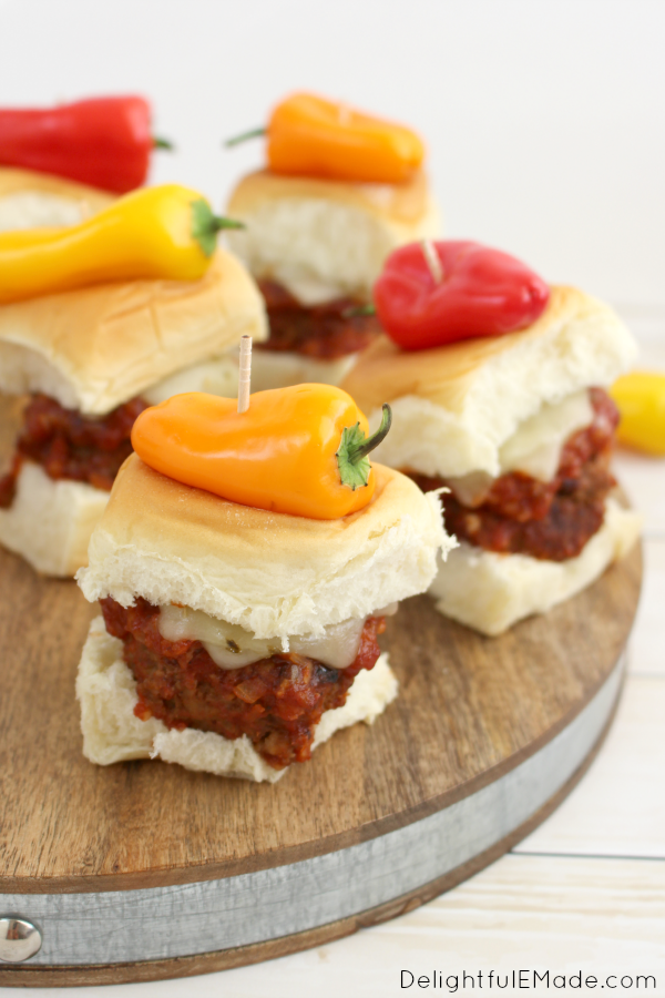 These Sweet & Spicy Meatball sliders are incredible! Spicy meatballs paired with a sweet & spicy sauce, topped with pepper jack cheese and served up on sweet rolls and topped with a sweet pepper! Perfect for tailgating or watching the big game at home!